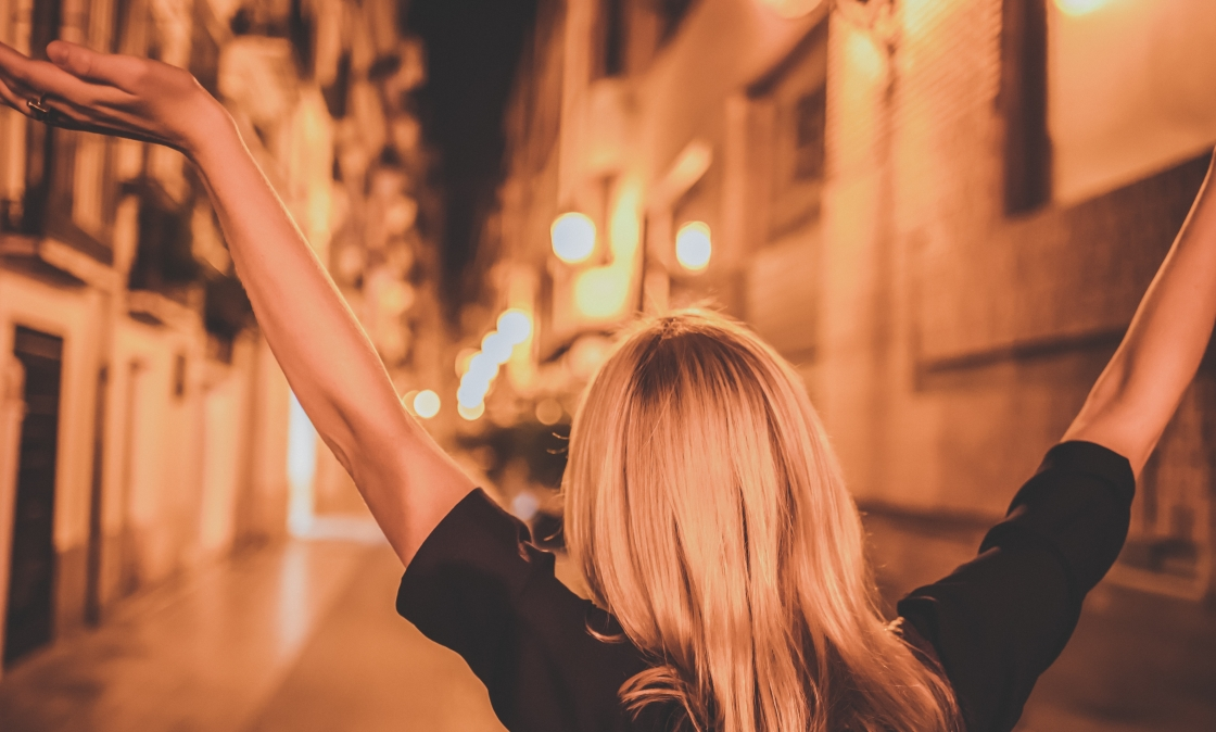 Photo of woman with arms up by Cyrus Crossan on Unsplash